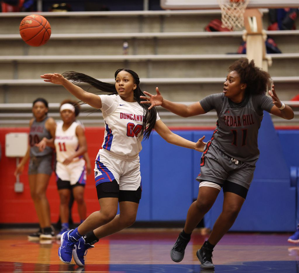 Duncanville's Hope LeMelle (00) defends as a pass makes its way towards Cedar Hill's Portia Adams (11) during the first half of play at Sandra Meadows Arena at Duncanville High School on Tuesday, January 12, 2021 in Dallas. (Vernon Bryant/The Dallas Morning News)