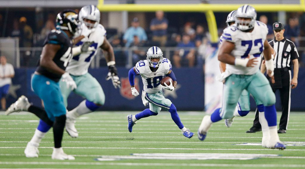 FILE - Cowboys receiver Tavon Austin (10) runs upfield with offensive tackle Tyron Smith (77) and center Joe Looney (73) leading the way in a game against the Jacksonville Jaguars at AT&T Stadium in Arlington on Sunday, Oct. 14, 2018. (Vernon Bryant/The Dallas Morning News)