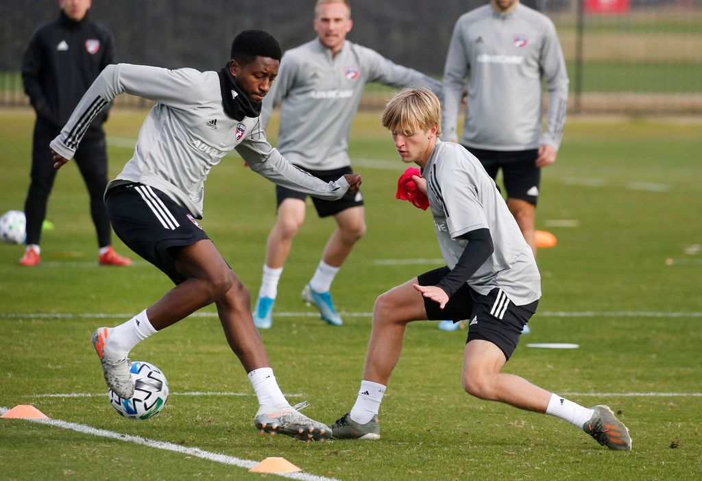 FC Dallas midfielder Eddie Munjoma (27) and FC Dallas midfielder Thomas Roberts (23) compete during a drill at the first practice of preseason training at Toyota Soccer Center in Frisco on Tuesday, January 21, 2020.
