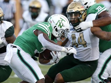 North Texas Mean Green running back DeAndre Torrey (3) tries to get past UAB Blazers defensive lineman Antonio Moultrie (44) during the first half as UNT hosted the University of Alabama Birmingham at Apogee Stadium in Denton on, Saturday, September 18, 2021. (Stewart F. House/Special Contributor)