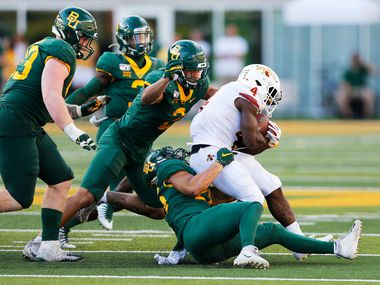 Iowa State Cyclones running back Johnnie Lang (4) is tackled by Baylor Bears linebacker Terrel Bernard (26), Baylor Bears linebacker Blake Lynch (2) and Baylor Bears defensive tackle James Lynch (93) during the second half of play at McLane Stadium in Waco, Texas on Saturday, September 28, 2019. Baylor Bears defeated Iowa State Cyclones 23-21. (Vernon Bryant/The Dallas Morning News)