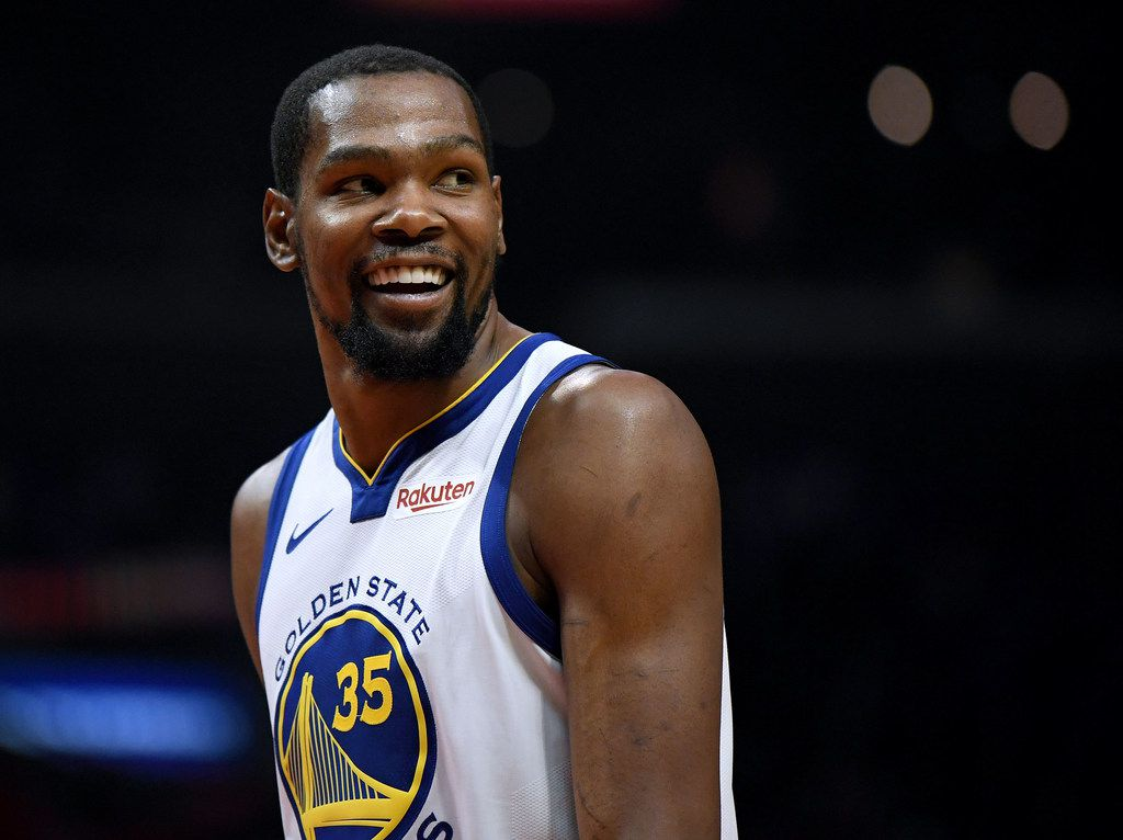LOS ANGELES, CALIFORNIA - APRIL 26:  Kevin Durant #35 of the Golden State Warriors smiles at his bench in a 129-110 win over the LA Clippers during Game Six of Round One of the 2019 NBA Playoffs at Staples Center on April 26, 2019 in Los Angeles, California. (Photo by Harry How/Getty Images)