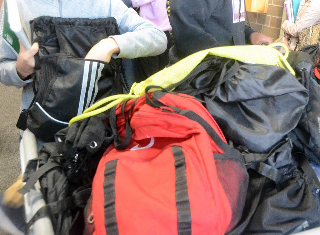 A student empties the contents of a drawstring bag while entering Hazleton Area High School in Hazle Townshp, Pa., on March 5, 2018, the first day students were banned from bringing backpacks and drawstring bags to school.