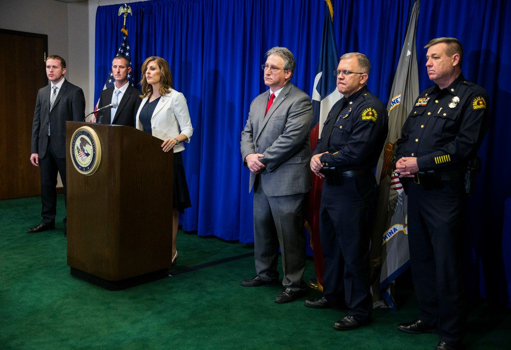 U.S. Attorney Erin Cox announces the Dallas arrest of several members of the Aryan Brotherhood on April 30, 2018, at the Earle Cabell Federal Building in downtown Dallas. Captain Phillip Fuller of the Texas Department of Public Safety is second from left, and Texas Anti-Gang Center Administrator Todd Reichert is third from right.