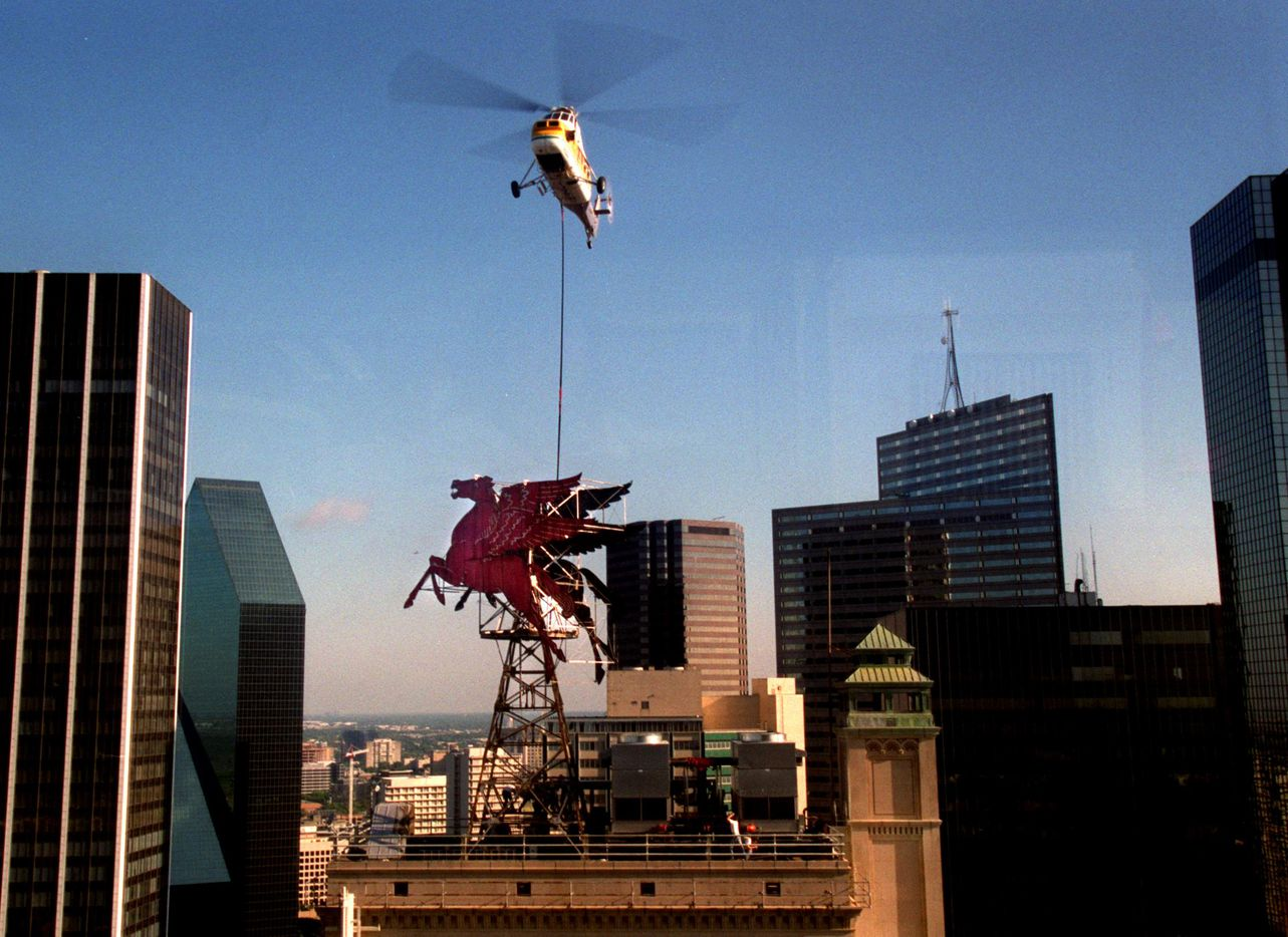 In 1999, workers used a helicopter to lower a crane next to Dallas' historic icon, Pegasus, during the project to replace the Flying Red Horse atop the Magnolia Hotel in Dallas. A new Pegasus, costing $600,000, took its place and was fully illuminated at the stroke of midnight on Jan. 1, 2000.