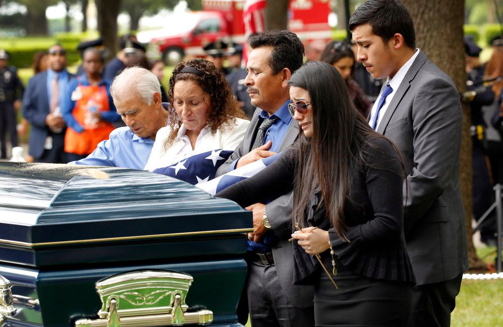 Family members of fallen Dallas police Officer Rogelio Santander grandfather Ignacio Garcia (from left), mother Julia Santander, father Rogelio Santander Sr., girlfriend Jennifer Rivera and brother Chris Santander say their goodbyes.