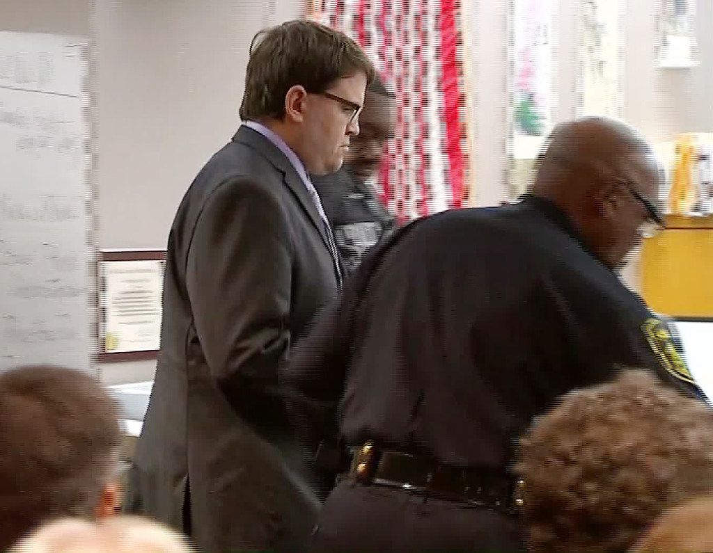 Former neurosurgeon Christopher Duntsch is escorted by officers during his trial in 2017.