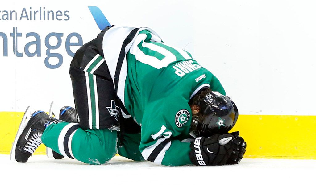 Dallas Stars left wing Patrick Sharp (10) lays on the ice after hitting his head on a check by the Los Angeles Kings in the second period at the American Airlines Center in Dallas, Thursday, October 20, 2016. Sharp left the game with concussion symptoms. (Tom Fox/The Dallas Morning News)