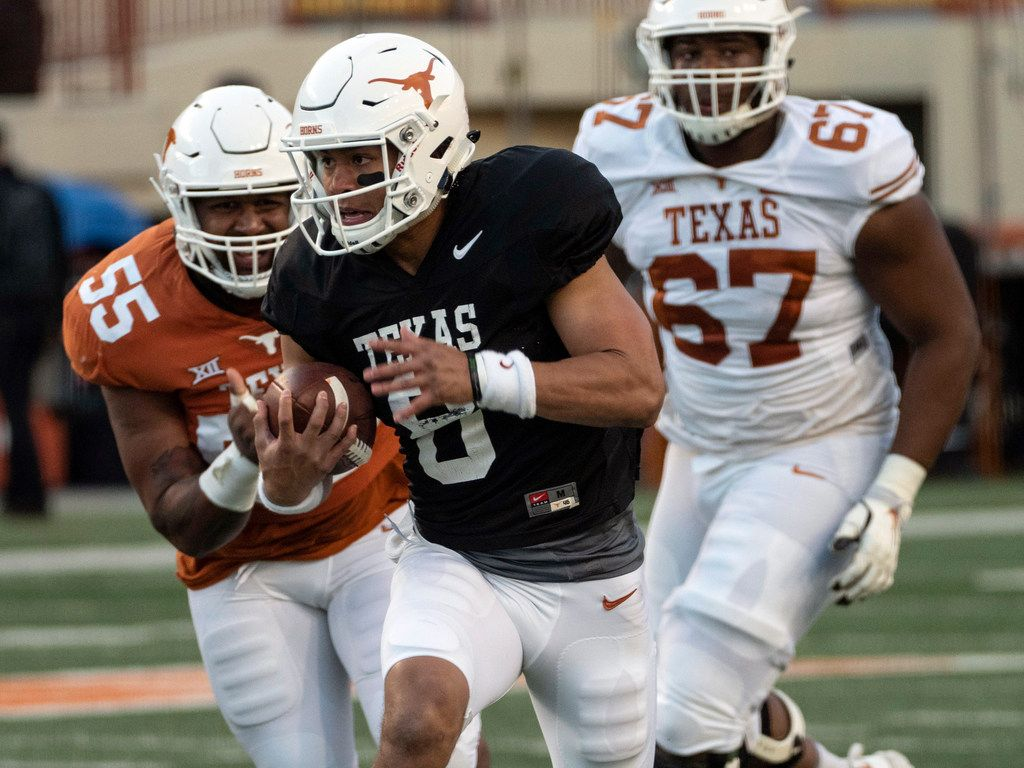 FILE - Texas quarterback Casey Thompson (8) scrambles for a first down as he's chased by defensive lineman D'Andre Christmas-Giles (55) during the Orange and White spring game at Darrel K Royal-Texas Memorial Stadium on Saturday, April, 13, 2019, in Austin.