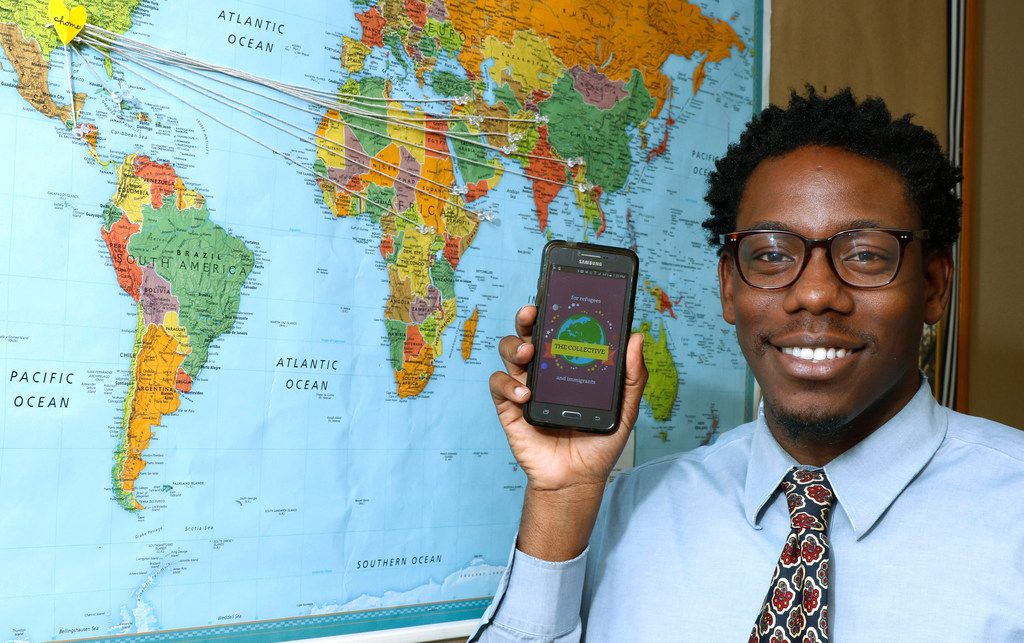 Derek Smith, 30, a caseworker at the International Rescue Committee in Dallas holds his phone with an App in his office he created to help refugees and all immigrants' with practical tools to navigate lifein the Dallas. The App is called, Collective for Refugees and Immigrants. The App will help point newcomers in the right direction 24-7 for bus services, health clinics, and other needs. Photo taken on Monday, December 11, 2017. (David Woo/The Dallas Morning News)