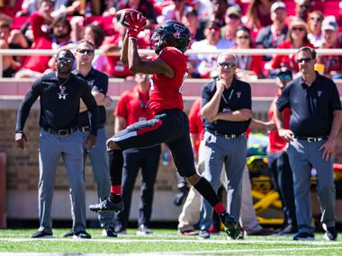 LUBBOCK, TEXAS - OCTOBER 05: Wide receiver Erik Ezukanma #84 of the Texas Tech Red Raiders catches a pass during the second half of the college football game against the Oklahoma State Cowboys on October 05, 2019 at Jones AT&T Stadium in Lubbock, Texas. (Photo by John E. Moore III/Getty Images)