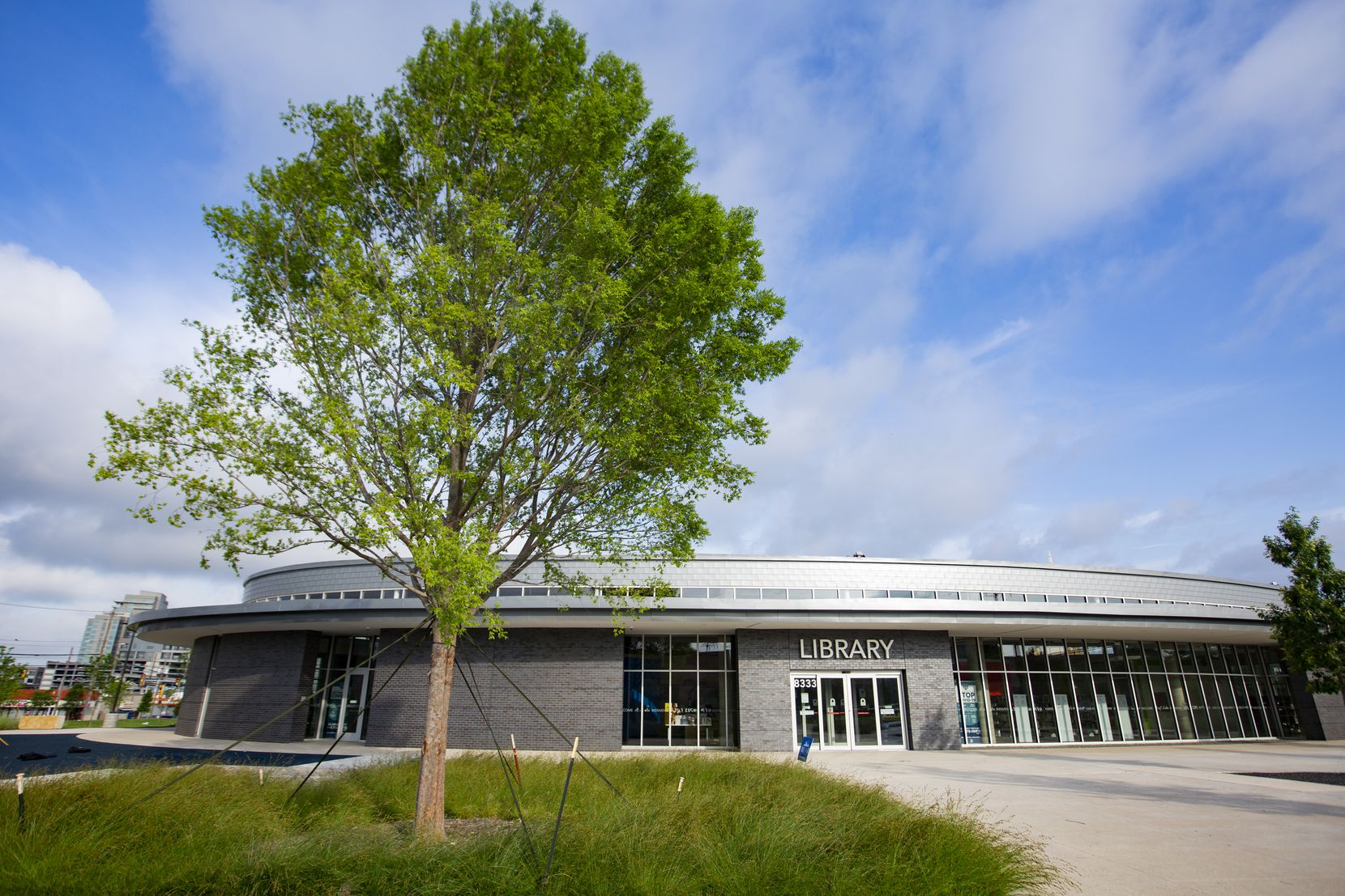The new Vickery Park Branch Library's thoughtful modern design shows off clean lines and a cool material palette that aims for a high level of sustainability.