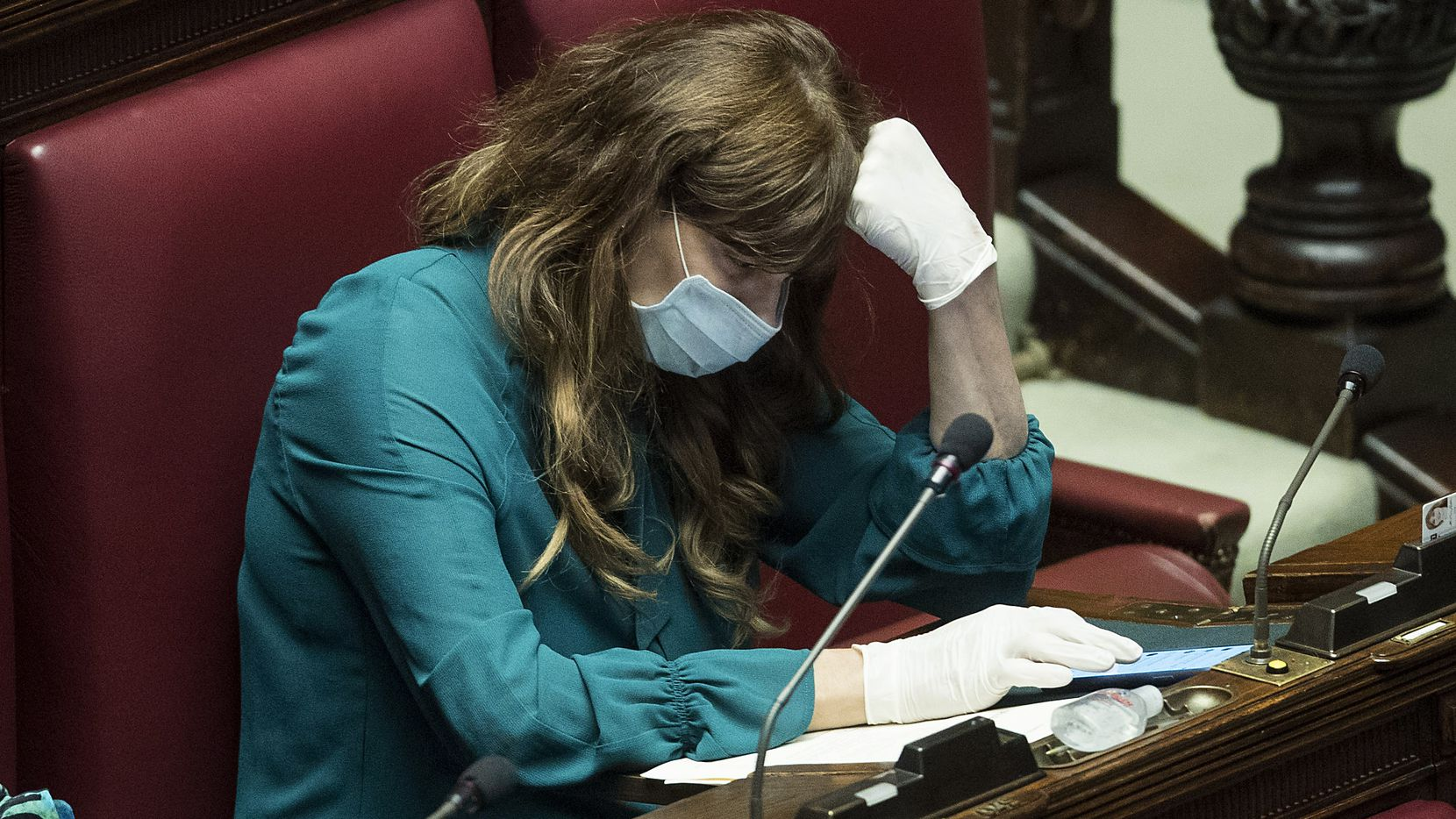 Italian lawmaker Maria Teresa Baladini wore a face mask and gloves during a session in Parliament on Wednesday.