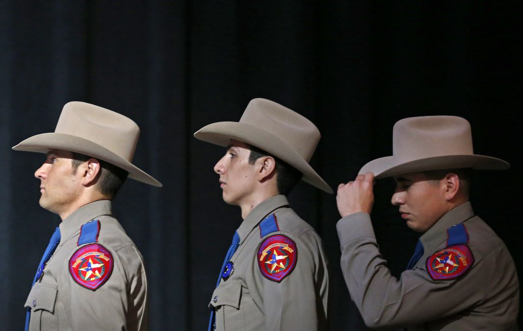 From left: Recruits for the Texas Department of Public Safety Alex Amador, Osvaldo Anzaldua and David Arias lined up during a recent DPS trooper graduation ceremony at Shoreline Church in Austin.