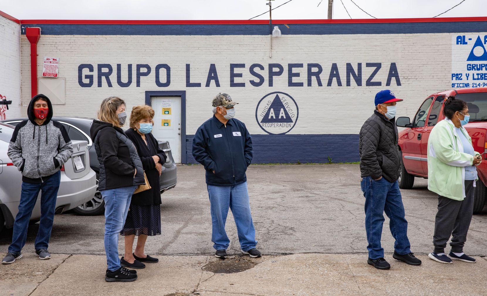 People 65 and older or at least 16 with underlying medical conditions register for a COVID-19 vaccine appointment at the registration site outside of Jerry's Supermarket on West Jefferson Boulevard in Dallas on Friday, Jan. 22, 2021. (Juan Figueroa/ The Dallas Morning News)