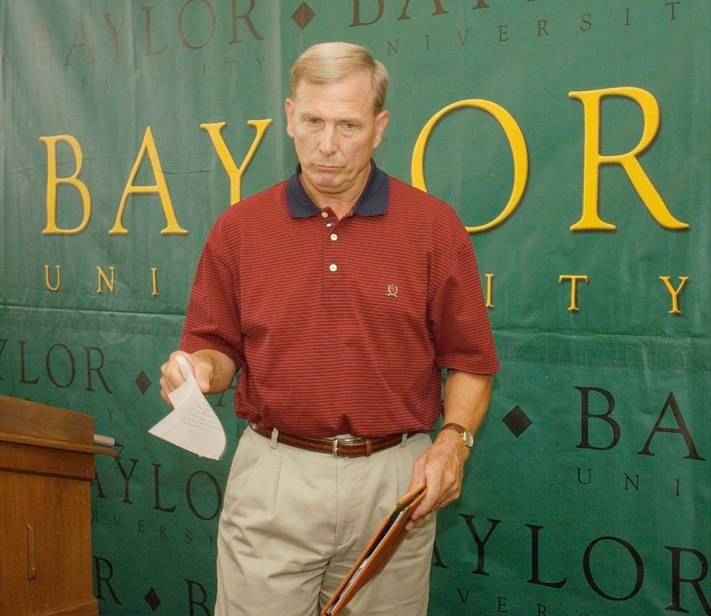 Baylor basketball coach Dave Bliss collects his notes after announcing his resignation, Friday, Aug. 8, 2003 in Waco, Texas. Bliss resigned Friday because of violations in his program that became known after the disappearance and death of a player allegedly killed by a former teammate. Baylor president Robert Sloan said the school has discovered major violations regarding players getting paid and improper drug testing.