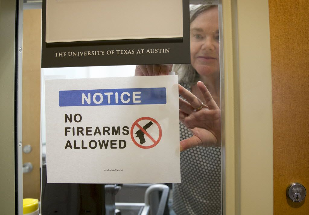 University of Texas at Austin Anthropology professor Pauline Strong posts a sign prohibiting guns at her office on the first day of the new campus-carry law Monday, Aug. 1, 2016. The law pushed by Gov. Greg Abbott and the Republican legislative majority will make Texas one of a handful of states that guarantee the right to carry concealed handguns on campus. (Jay Jenner/Austin American-Statesmanvia AP)