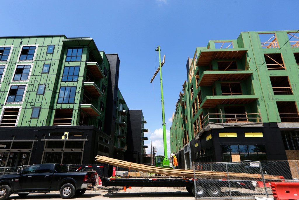 Construction workers were busy last September on the latest apartment complex going up in downtown Plano.