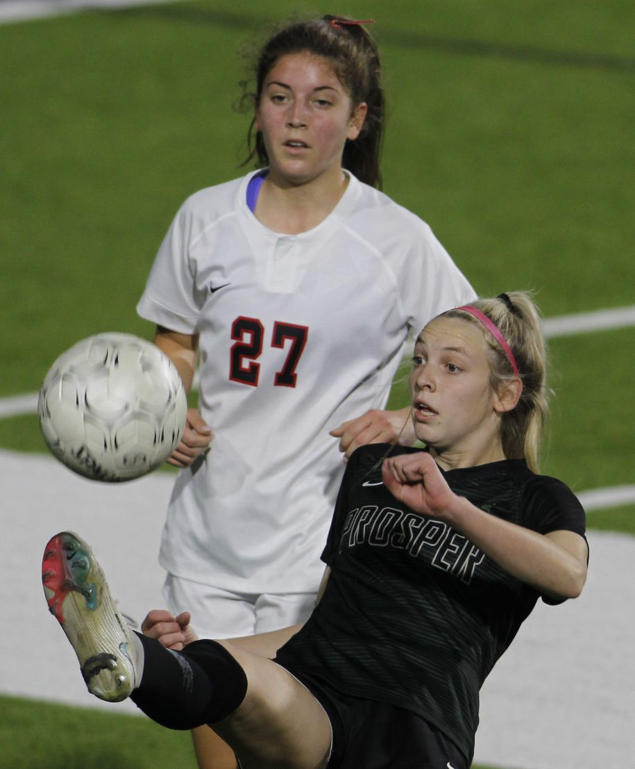 Prosper's Hadley Murrell (10) shows her athleticism as she saves the ball and possession as Coppell's Tatum Escobar (27) moves in defensively during first half action. The two teams played their Class 6A bi-district girls soccer playoff game at McKinney ISD Stadium in McKinney on March 26, 2021. (Steve Hamm/ Special Contributor)