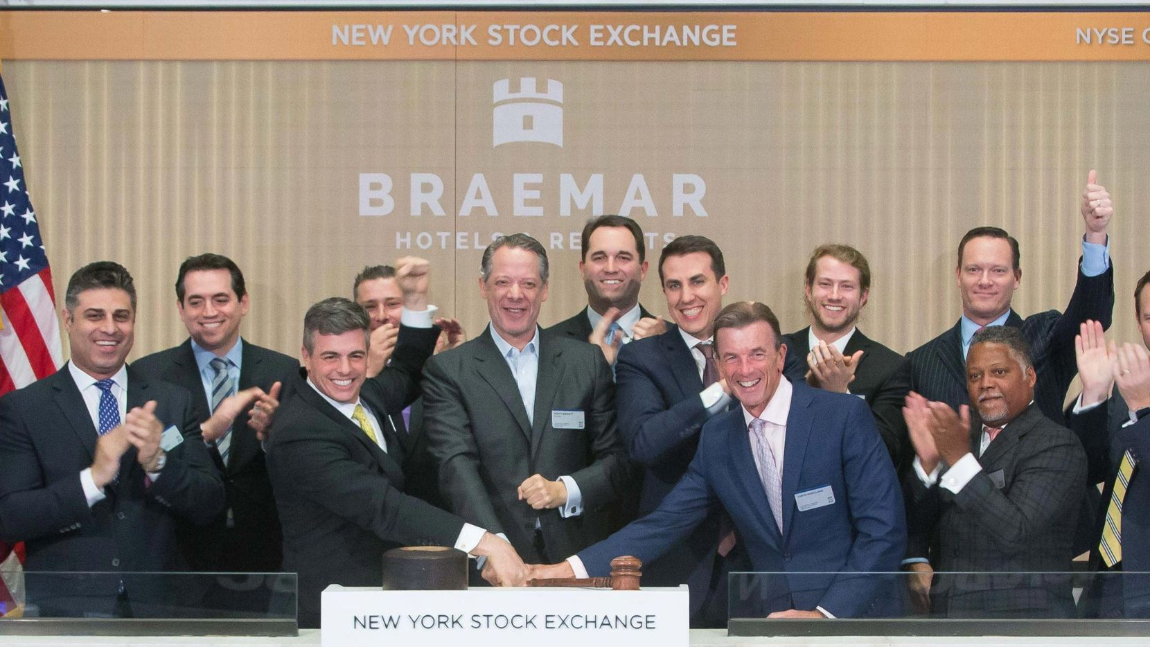 Dallas hotel executive Monty Bennett (center) rang the closing bell at the New York Stock Exchange in 2018 for one of the hotel real estate investment trusts that he chairs.