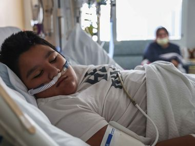 Francisco Rosales, 9, is being treated for COVID-19 in the pediatric intensive care unit at Children's Medical Center Dallas on Friday, Aug. 13, 2021. Rosales has been hospitalized since Aug. 8 when his blood oxygen level was at 62%, according to his mother, Yessica Gonzalez. (Lola Gomez/The Dallas Morning News)