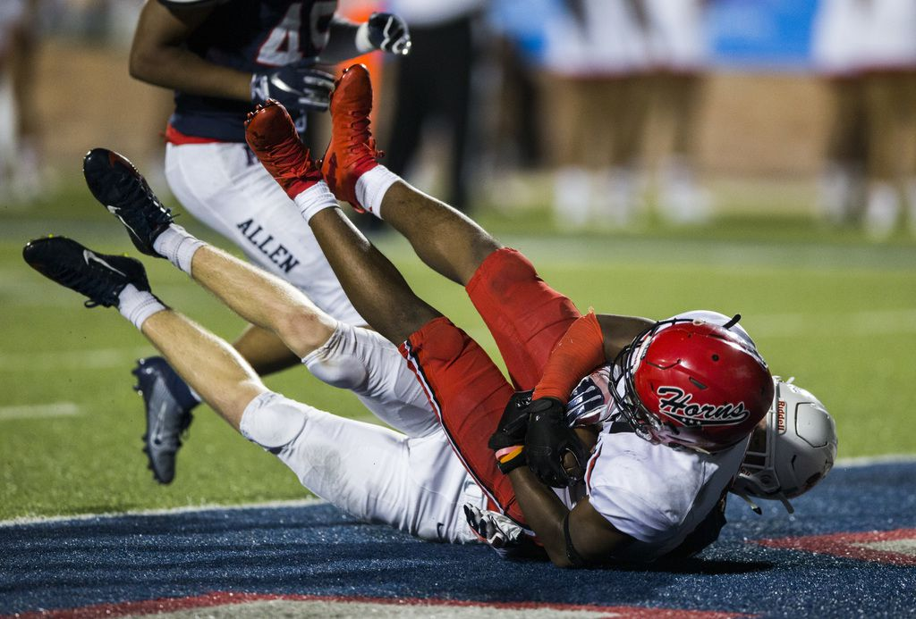 Allen linebacker Jett Waters (17) tackles Cedar Hill running back Corie Allen (10) as Allen falls in to the end zone for a touchdown during the fourth quarter of a high school football game between Allen and Cedar Hill on Friday, August 30, 2019 at Eagle Stadium in Allen. (Ashley Landis/The Dallas Morning News)