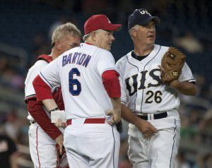 From left, catcher Rep. Todd Platts, R-Pa., manager Joe Barton, R-Texas, and pitcher John Shimkus, R-Ill., confer on the mound during the 49th Annual Roll Call Congressional Baseball Game at Nationals Stadium in Washington on Tuesday, June 29, 2010.