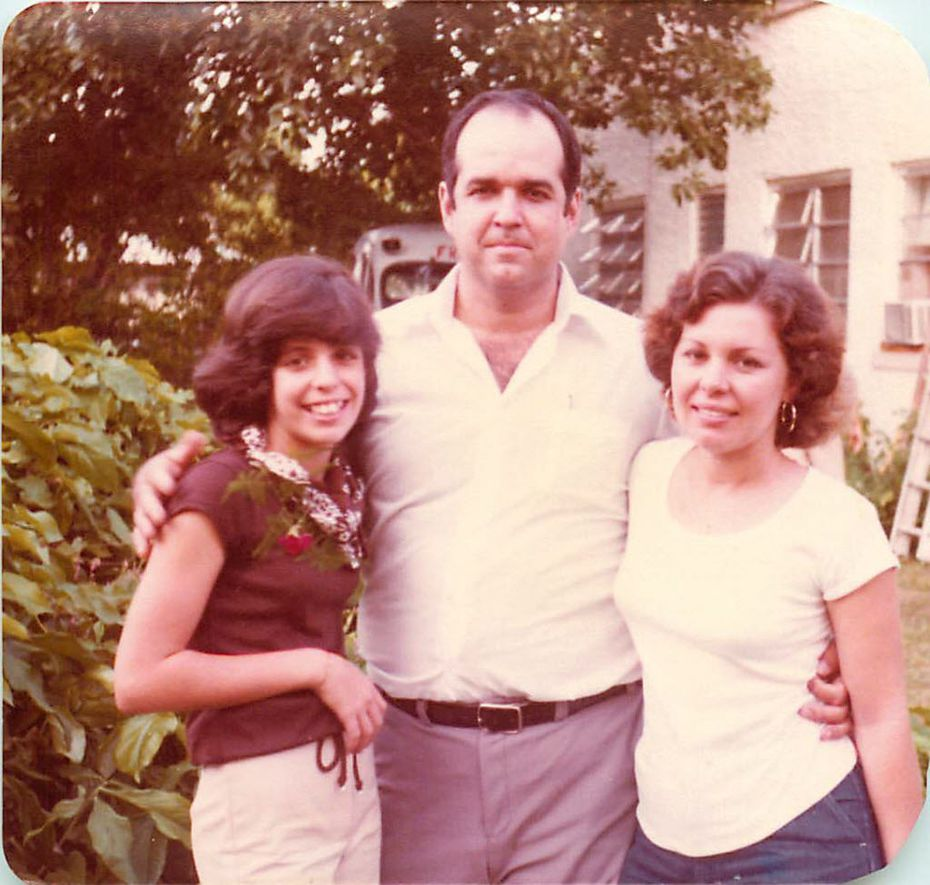 Yvette Ostolaza, left, age 12, with her parents, Oscar and Carmen Ostolaza at a friend's barbecue.