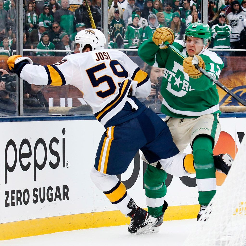 Dallas Stars center Mattias Janmark (13) gives a forearm check to Nashville Predators defenseman Roman Josi (59) during the third period of the NHL Winter Classic hockey game at the Cotton Bowl in Dallas, Wednesday, January 1, 2020. The Stars came back to win, 4-2. (Tom Fox/The Dallas Morning News)