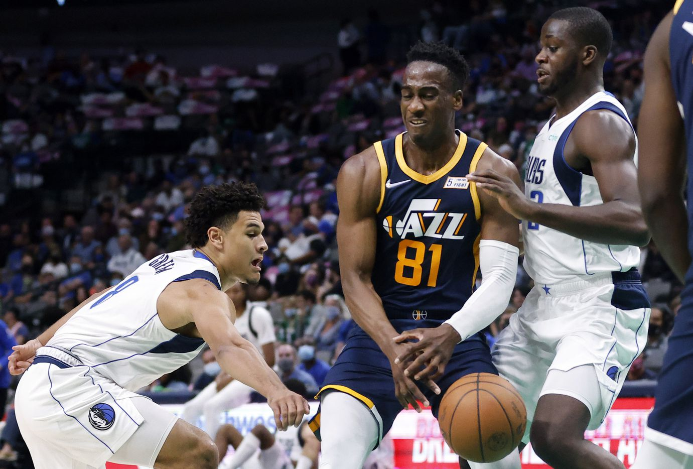 Dallas Mavericks guard Josh Green (8) and forward Eugene Omoruyi (2) strip the ball from Utah Jazz guard Miye Oni (81) during the second half at the American Airlines Center in Dallas, Wednesday, October 6, 2021. The Mavericks defeated the Jazz, 111-101. (Tom Fox/The Dallas Morning News)