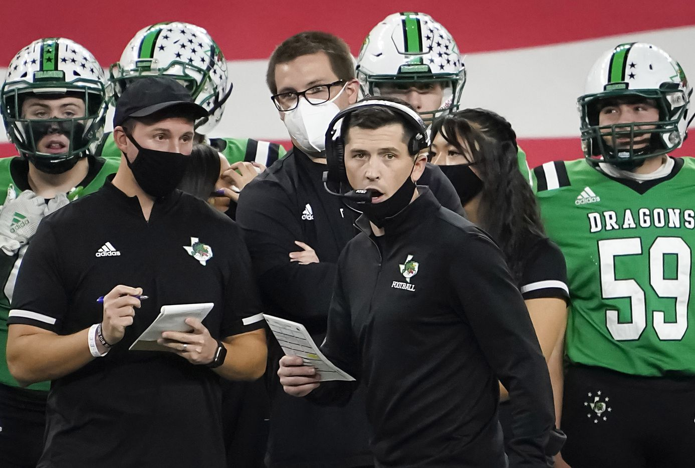 Southlake Carroll head coach Riley Dodge calls in a play during the first quarter of the Class 6A Division I state football championship game against Austin Westlake at AT&T Stadium on Saturday, Jan. 16, 2021, in Arlington, Texas.