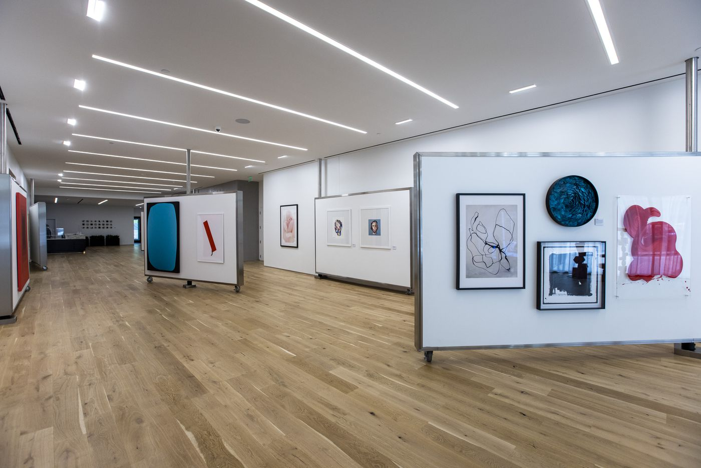 The main lobby of the Atelier, a 41-story luxury residential building in the heart of the Dallas Arts District, features a gallery of art work. (Lynda M. González/The Dallas Morning News)