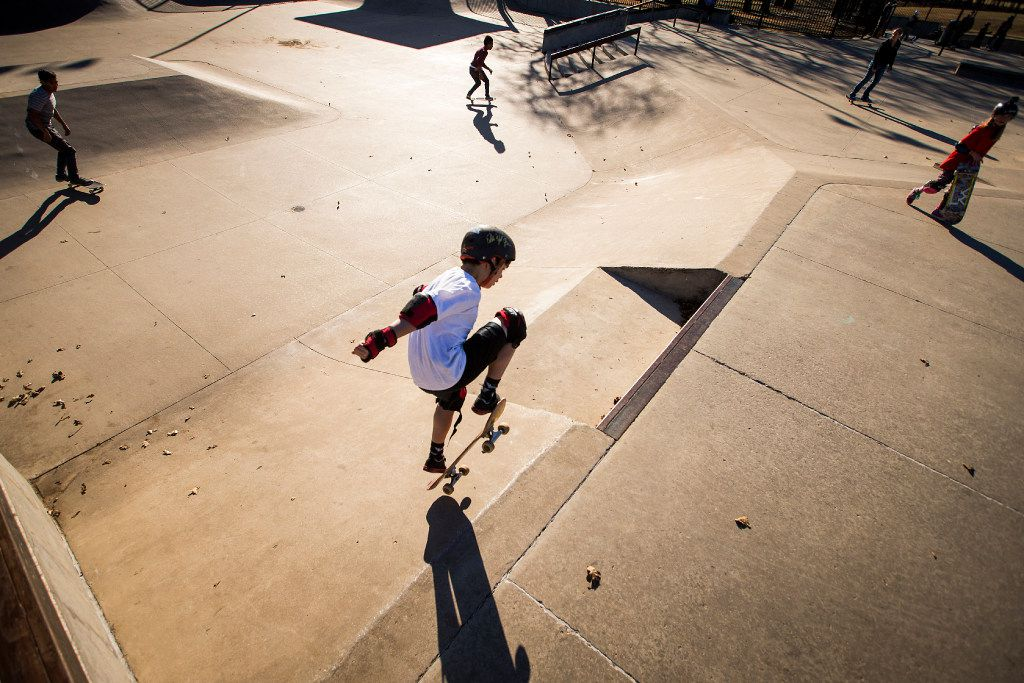 Travis Haley, 9, rides his skateboard at Lively Pointe Skate Park in Irving. (Smiley N. Pool/The Dallas Morning News)