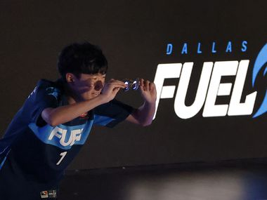 Dallas Fuel player Kim 'Sp9rk1e' Yeonghan acknowledges his fans as he's introduced before their Overwatch League game against the Houston Outlaws at Esports Stadium Arlington Friday, July 9, 2021.