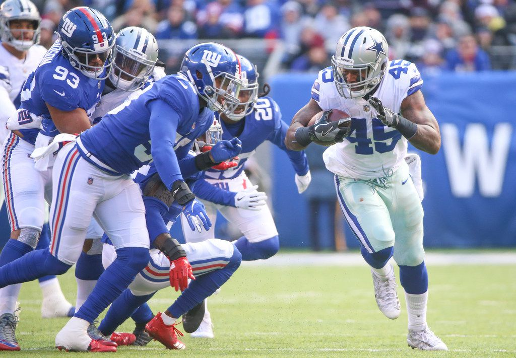 Dallas Cowboys running back Rod Smith (45) carries the ball as a herd of New York Giants defenders follow in the first half of an NFL football game at MetLife Stadium in East Rutherford, New Jersey on Sunday, Dec. 30, 2018. (Shaban Athuman/The Dallas Morning News)