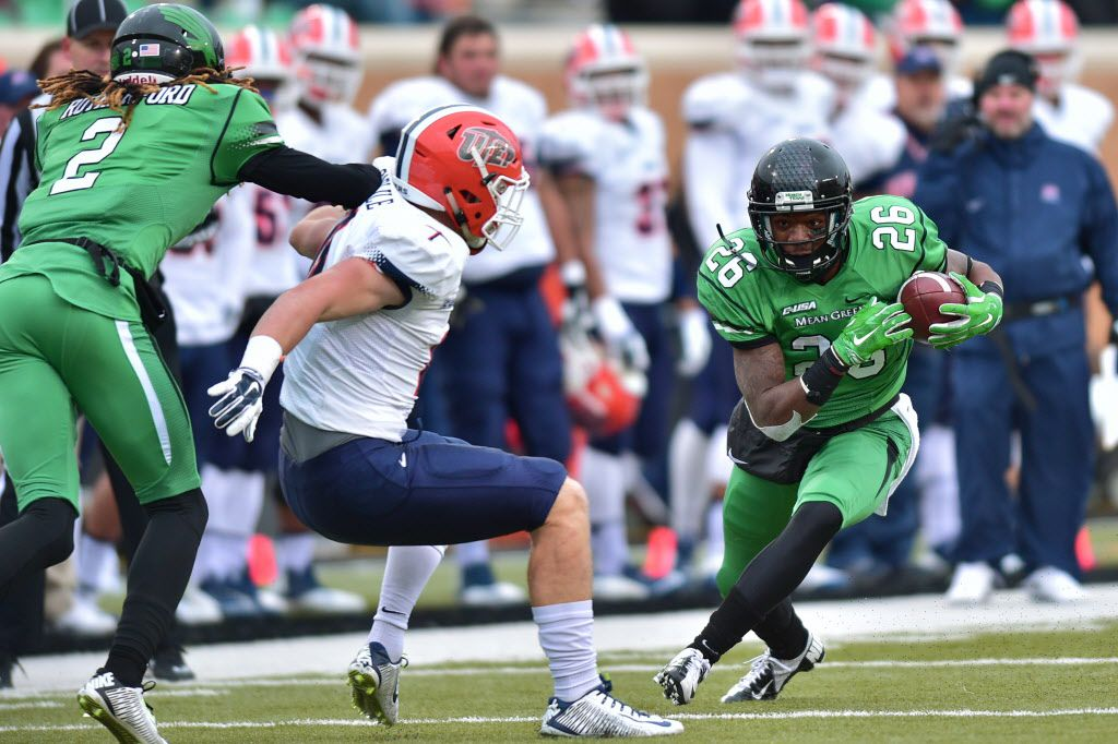 North Texas sophomore running back Jeffrey Wilson (26) looks for room to run after a catch against Texas-El Paso, Saturday, November 28, 2015, at Apogee Stadium in Denton, TX. David Minton/DRC