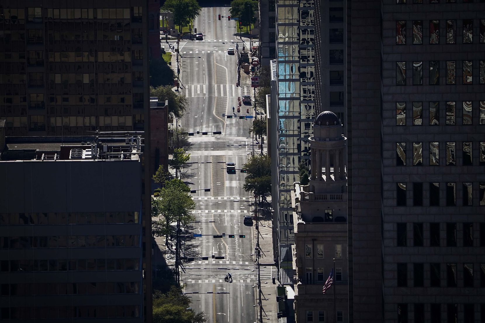 A nearly empty Main Street in downtown Dallas just after 5:00 p.m. on Tuesday, March 24, 2020, when the business day would normally be ending and commuters typically pour out to head home.
