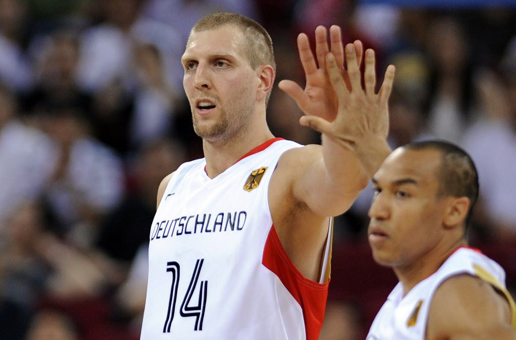 Germany's Dirk Nowitzki (L) and Demond Green celebrate a point during a 2008 Beijing Olympic Games men's preliminary round group B match against Angola at the Olympic Basketball Gymnasium in Beijing on August 10, 2008.