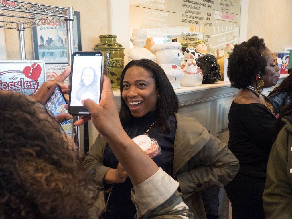 Attendees of the Soul of Dallas bus tour pose for pictures at Kessler Baking Studio in Dallas on Feb. 2, 2019.