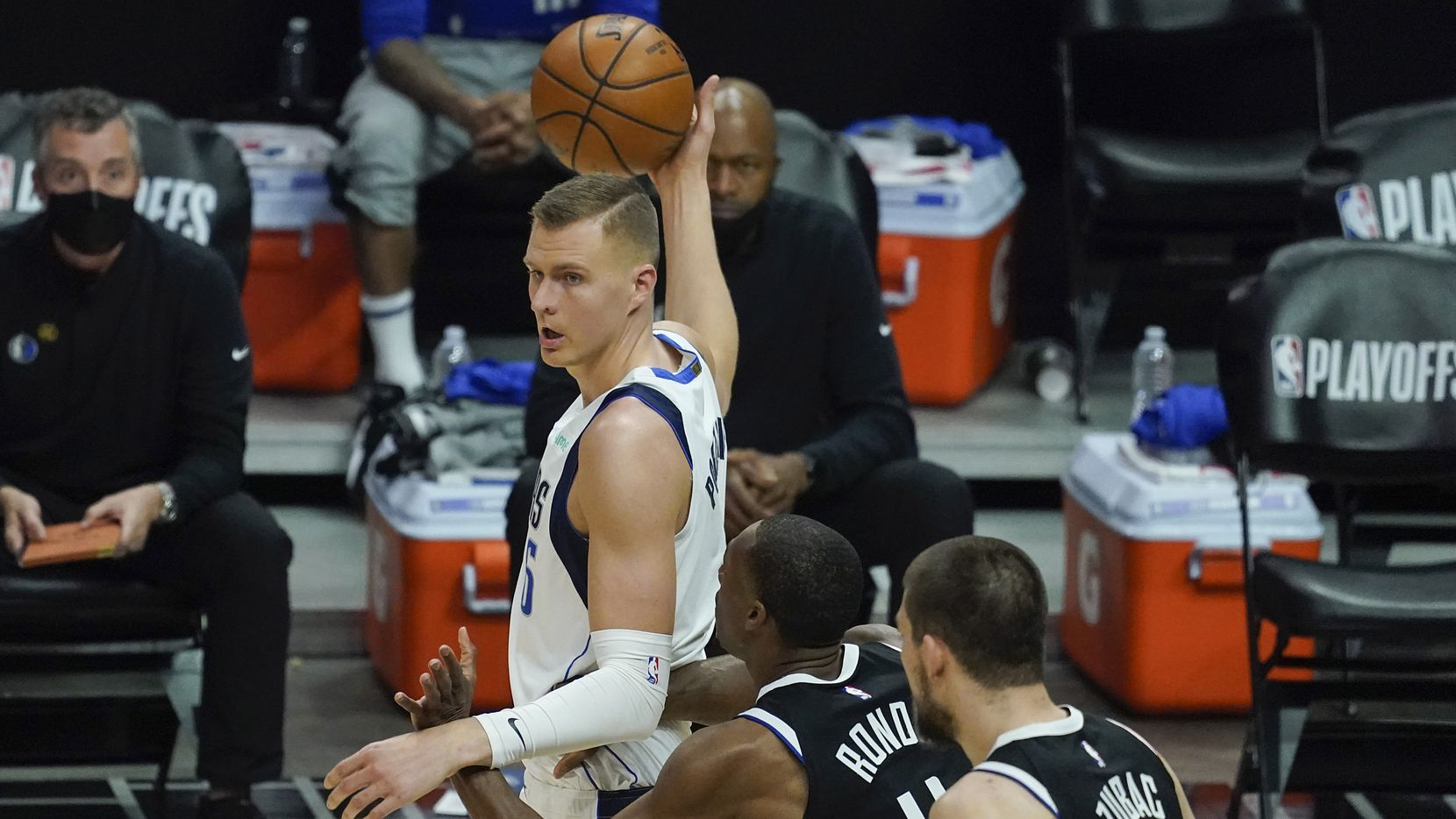 Dallas Mavericks center Kristaps Porzingis (6) works against LA Clippers guard Rajon Rondo (4) and center Ivica Zubac (40) during the first quarter of an NBA playoff basketball game at the Staples Center on Wednesday, June 2, 2021, in Los Angeles.