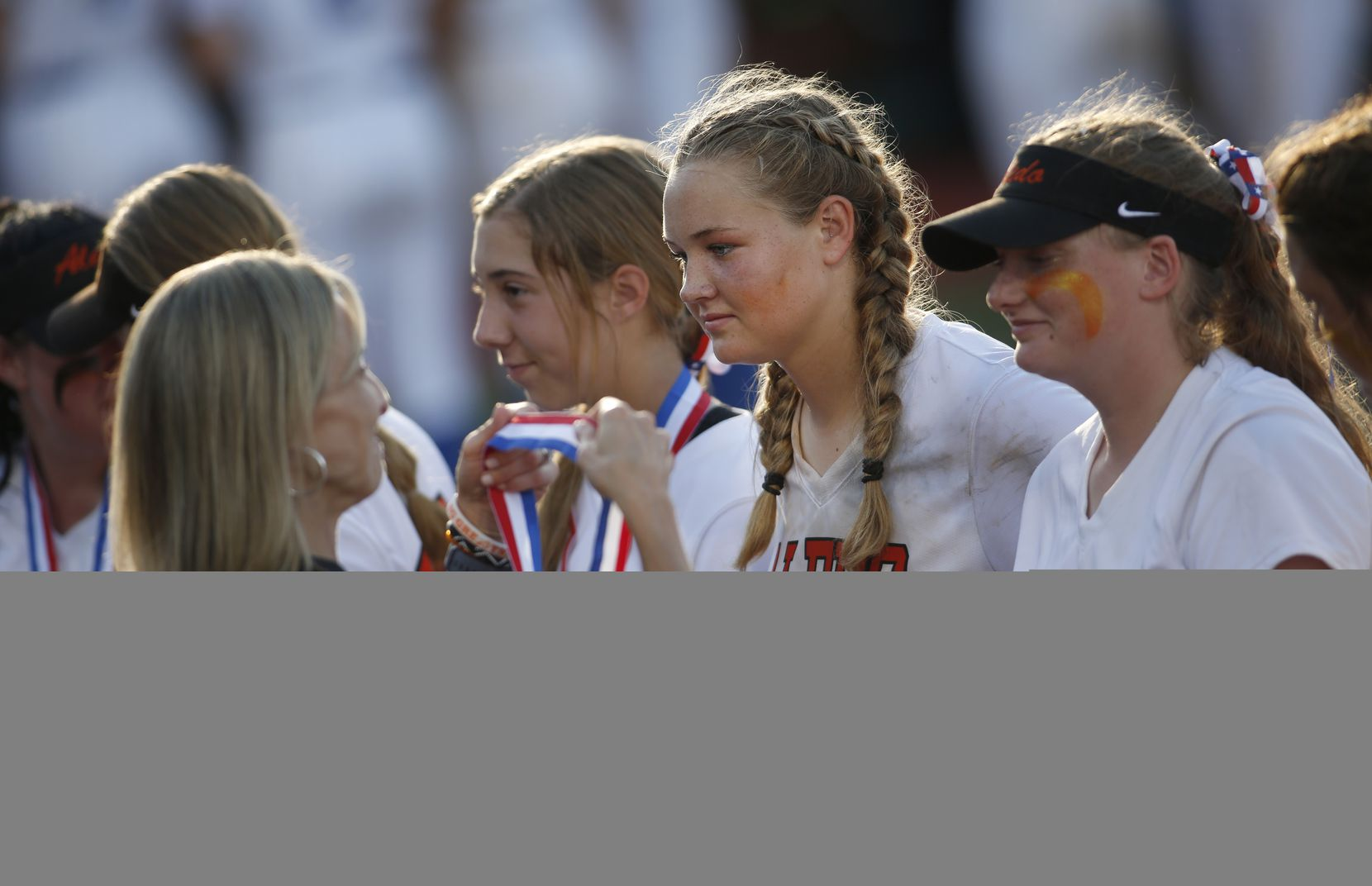 Aledo pitcher Kayleigh Smith (15) prepares to receive her state runner-up medal during the awards presentation after Barbers Hill defeated the Lady Cats, 4-1 , to capture the state title. The two teams played their UIL 5A state softball championship game at Red and Charline McCombs Field on the University of Texas campus in Austin on June 5, 2021. (Steve Hamm/ Special Contributor)