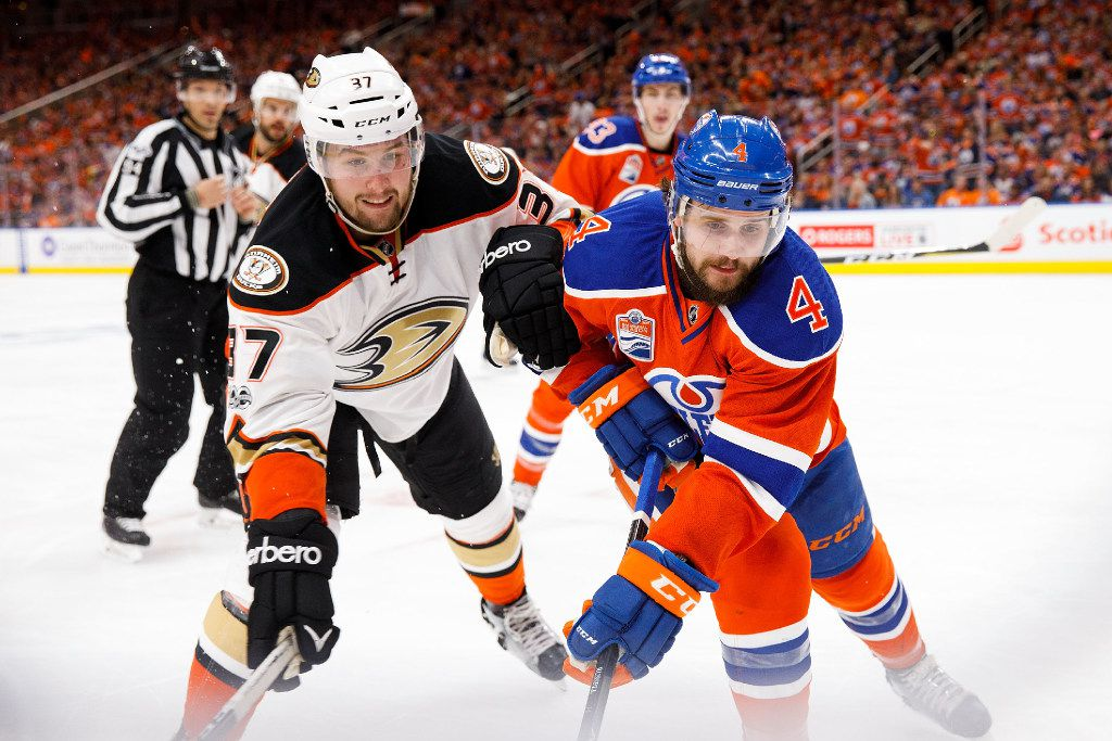 EDMONTON, AB - MAY 7:  Kris Russell #4 of the Edmonton Oilers battles against Nick Ritchie #37 of the Anaheim Ducks in Game Six of the Western Conference Second Round during the 2017 NHL Stanley Cup Playoffs at Rogers Place on May 7, 2017 in Edmonton, Alberta, Canada. (Photo by Codie McLachlan/Getty Images)