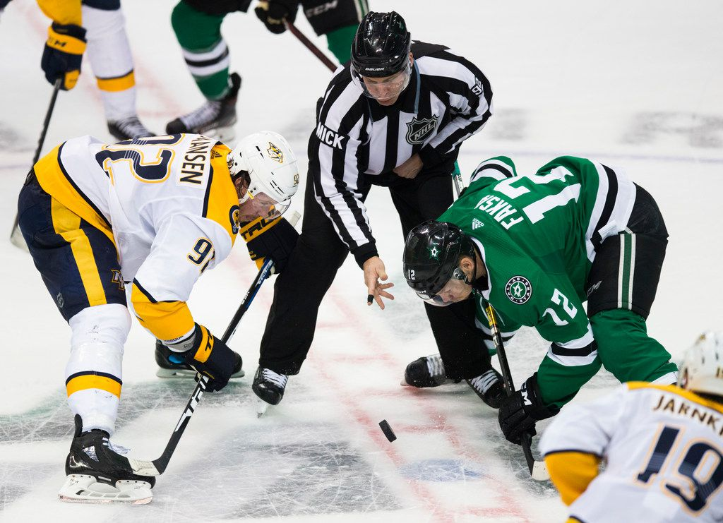 Dallas Stars center Radek Faksa (12) faces off against Nashville Predators center Ryan Johansen (92) during the third period of Game 3 of a playoff series between the Dallas Stars and the Nashville Predators on Monday, April 15, 2019 at American Airlines Center in Dallas. (Ashley Landis/The Dallas Morning News)