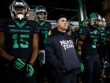 North Texas Mean Green head coach Seth Littrell and his players wait to be introduced before facing the Florida Atlantic Owls at Apogee Stadium in Denton, Texas, Thursday, November 15, 2018. (Tom Fox/The Dallas Morning News)
