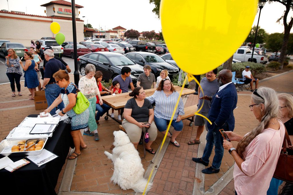 The community showed up to support businesses in Casa Linda Plaza shopping center following a controversial decision to remove historic trees to make way for more parking in Dallas, Friday, July 27, 2018. Shopping center restaurants brought free samples to folks gathered. (Tom Fox/The Dallas Morning News)