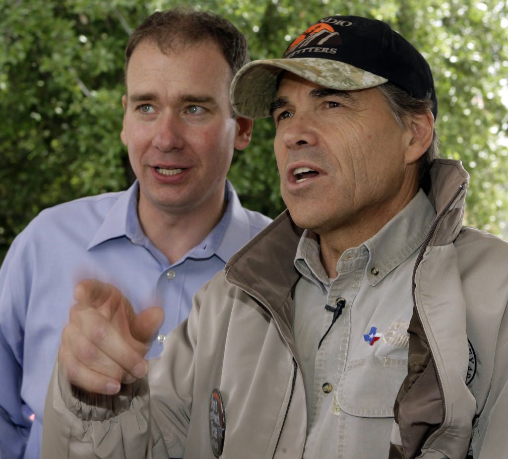 "Michael Quinn Sullivan talks with Texas Gov. Rick Perry before Perry's address to a ""Don't Mess With Texas"" tea party rally in April 2009 at Austin City Hall."