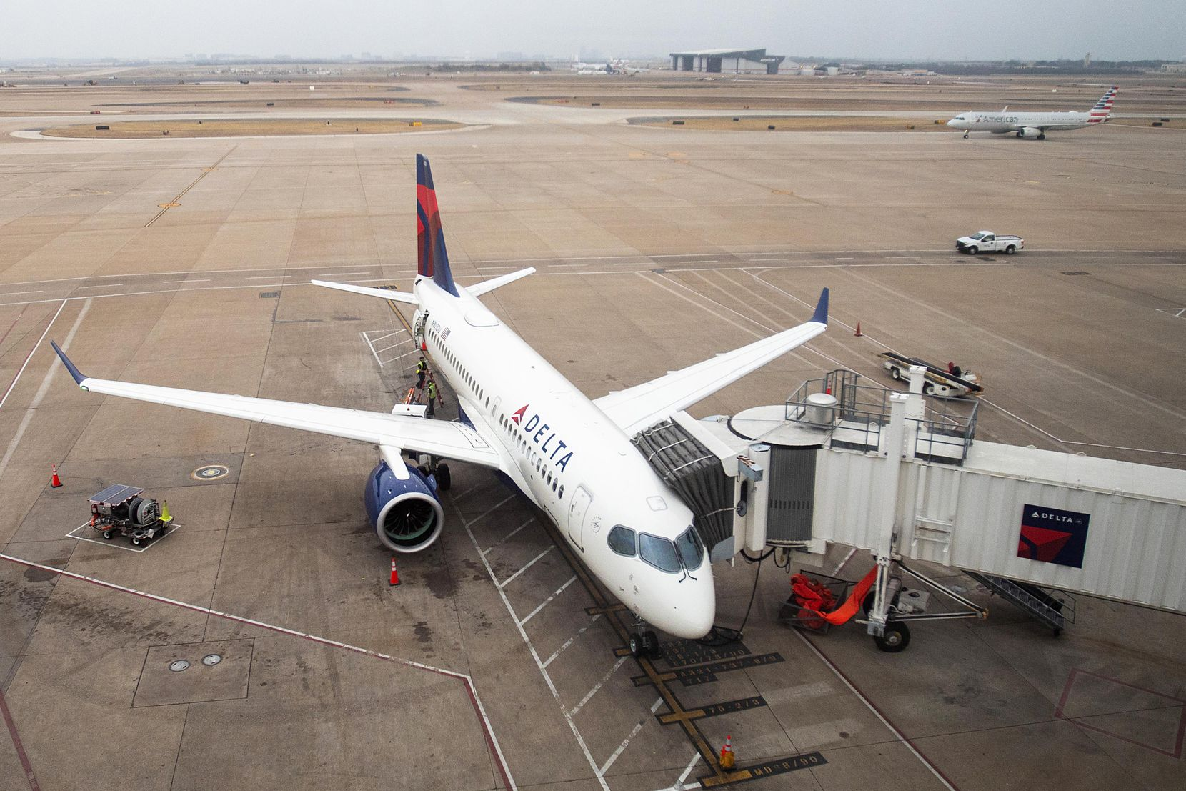 Delta's new Airbus A220-100 airplane sits parked at gate E15 of Terminal E at DFW Airport on Wednesday, Feb. 6, 2019.