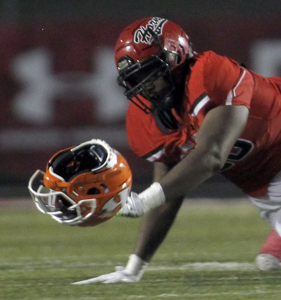 Cedar Hill Longhorns defensive end Syncere Massey (90) eyes the empty helmet as it got separated from Rockwall running back Zach Hernandez (2) during a first half rush. Cedar Hill received a face mask penalty on the play. Cedar Hill and Rockwall played theirseason opening football game at Longhorn Stadium in Cedar Hill on August 27, 2021. (Steve Hamm/ Special Contributor)
