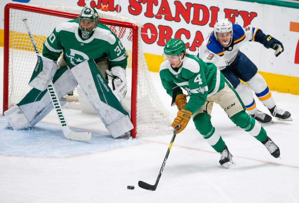 Dallas Stars defenseman Miro Heiskanen (4) makes a break down the ice past St. Louis Blues left wing Sammy Blais (9) during the first period of an NHL matchup between the Dallas Stars and the St. Louis Blues on Friday, Feb. 21, 2020 at American Airlines Center in Dallas.