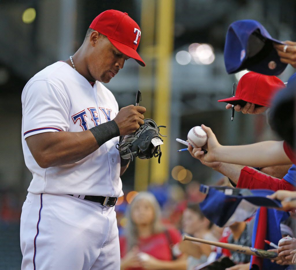 Texas Rangers third baseman Adrian Beltre (29) signs autographs before the Los Angeles Angels vs. the Texas Rangers major league baseball game at Globe Life Park in Arlington on Thursday, October 1, 2015. (Louis DeLuca/The Dallas Morning News)